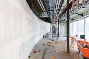 Photo inside the building of a curved wall